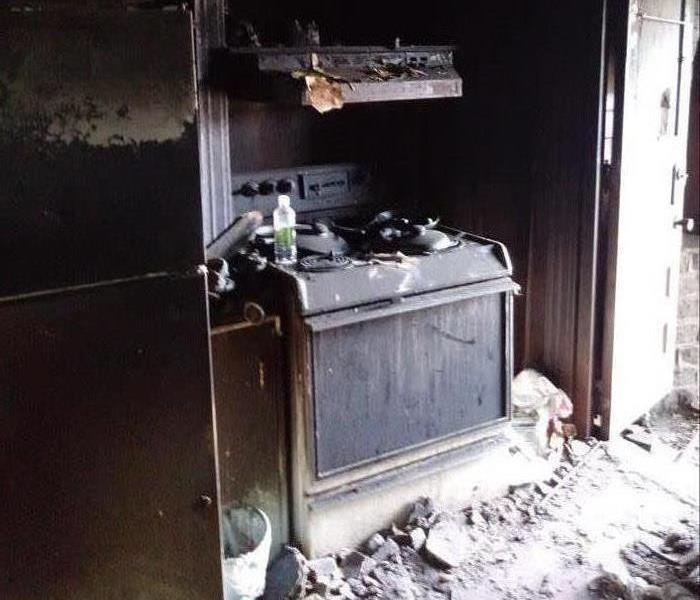 Oven Covered in Fire Debris